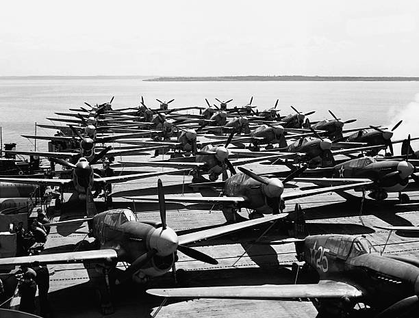 p40s-being-transported-aboard-location-aircraft-carrier-flight-deck-picture-id615311434?k=6&m=615311434&s=612x612&w=0&h=-mTBJn2n1UwL2XcnvTeJ02wGBaBuviMEVFr4kq0fkfU=