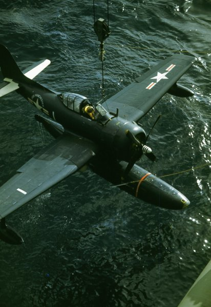 Curtiss_SC-1_Seahawk_is_craned_aboard_US