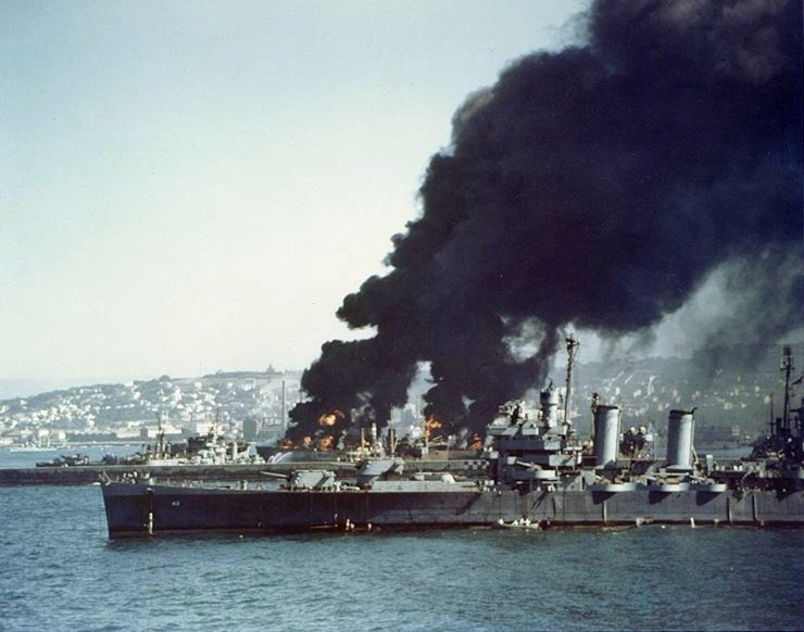 USS_Savannah_(CL-42)_with_burning_Libert