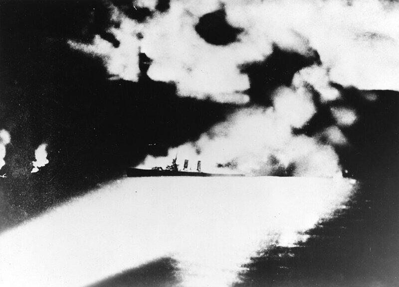 1280px-USS_Quincy_(CA-39)_under_fire_dur
