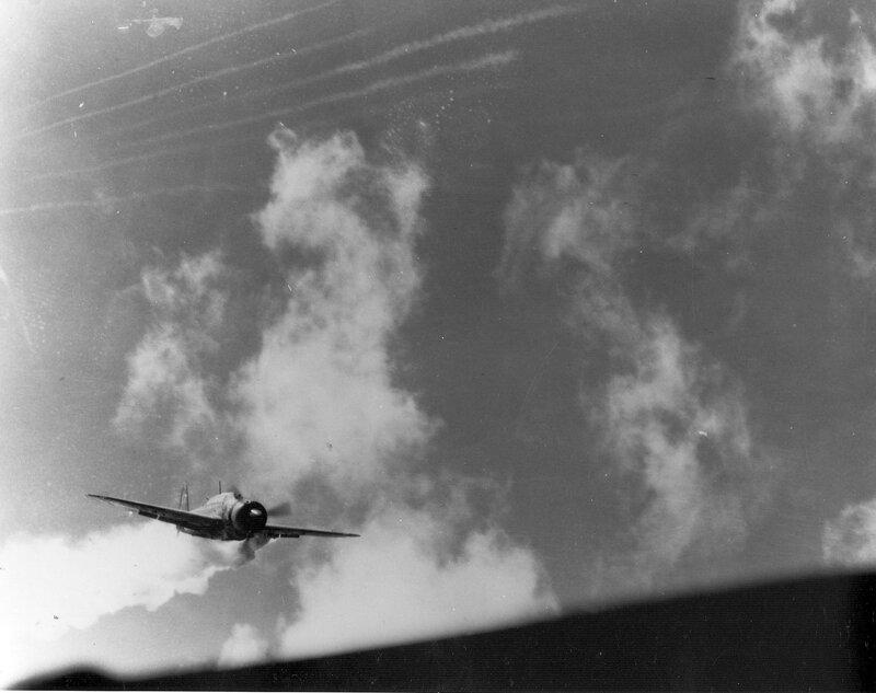Special attack pilot Lt. Yoshinori Yamaguchi's Yokosuka D4Y3 Model 33 diving at carrier Essex, at 1256 on 25 Nov 1944, photo 1 of 3