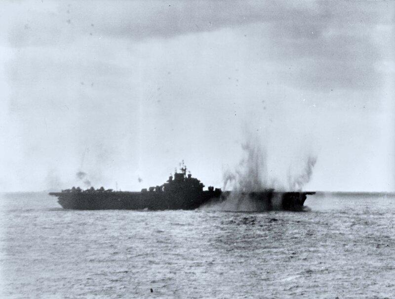 USS Essex under Japanese attack, off Japan, 19 Mar 1945
